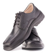 Black glossy mans shoes with shoelaces — Stock Photo