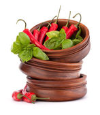 Hot red chili or chilli pepper in wooden bowls stack — Stock Photo
