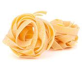 Italiaanse pasta fettuccine nest — Stockfoto