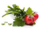 Spring onions and cherry tomato in bowl — Stock Photo