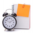 Alarm clock and blank notebook sheet. — Stock Photo #12283005