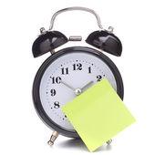 Reloj despertador con papel pegajoso — Foto de Stock