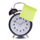 Alarm clock with sticky paper — Stock Photo