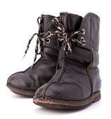 Vintage zchátralé dětské boty — Stock fotografie