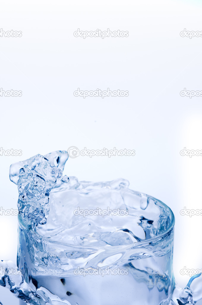 Splash of mineral water out of clean transparent glass — Stock Photo #11025594