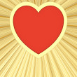 Red heart on background of golden rays — Stock Photo