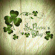 St.Patrick day greeting with shamrocks — Vector de stock #10783830