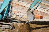 Operating excavator — Stock Photo