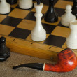 Chess and pipe — Stock Photo