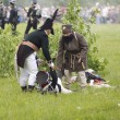 Borodino battle. Taking out the wounded man - Stock Photo