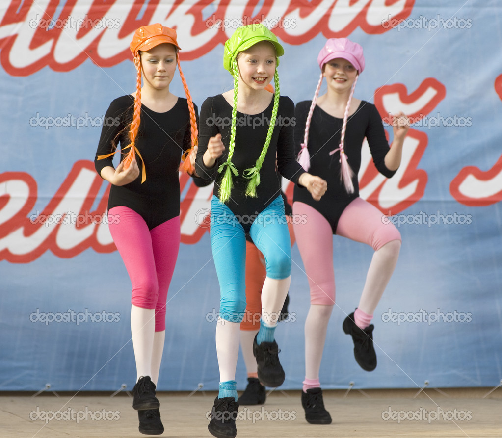 PODOLSK - MAY 9: Unidentified artists of ensemble of culture dance Rainbow kids dancing at event dedicated to Victory Day in WWII on May 9, 2012 in Podolsk, Russia  Stock Photo #10982255