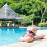 Beautiful girl at swimming pool with Bar at bacground — Stock Photo