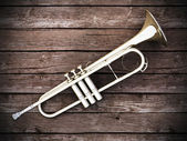 Trumpet on wood — Stock Photo
