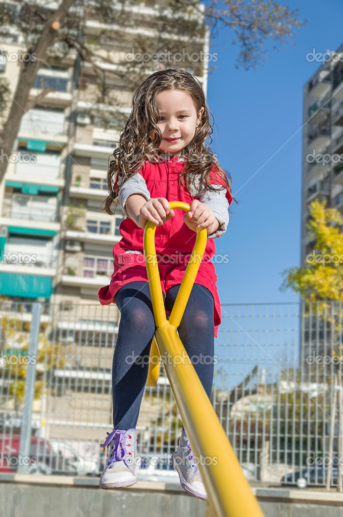Beautiful little girl in busy park — Stock Photo #11060700