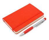 Red closed notepad and pen isolated on white — Stock Photo