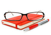 Red closed notepad, glasses and pen isolated on white — Stock Photo