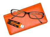 Notebook, glasses and pendrive isolated on white — Stock Photo