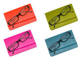 Closed notebook and glasses in set isolated on white — Stock Photo