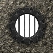 Stock Photo: Gear wheel prison window