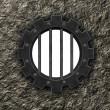 Gear wheel prison window — Stock Photo