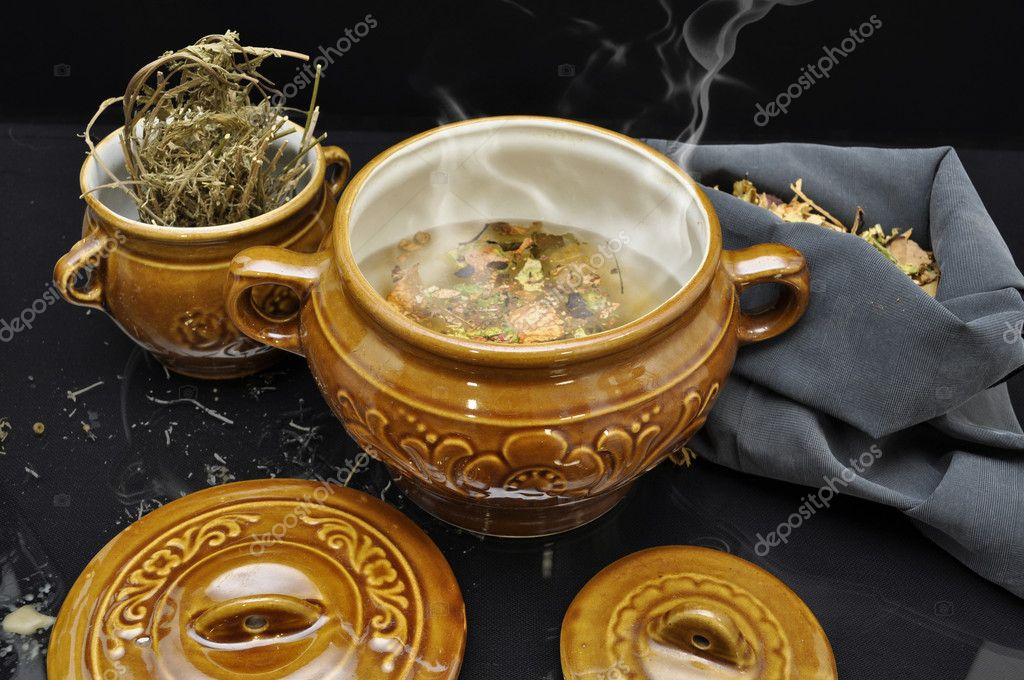 Magic potion preparation still life with two decorative pots and herbals — Stock Photo #12301900