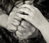 Old and child hands — Stock Photo