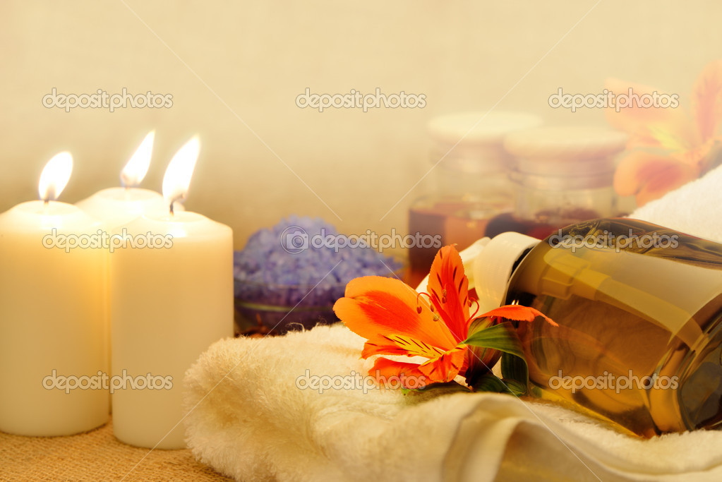 Object for the spa. Candles burning, pebble, a Lily, a bottle with oil, liquid soap, and more.  Stock Photo #10743855