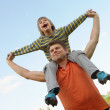 Happy son on the shoulders of the father — Stock Photo #11053733