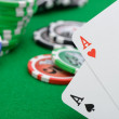 Gaming chips and cards on the green cloth — Stock Photo
