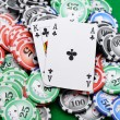Gaming chips and cards on the green cloth - Stock Photo
