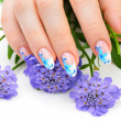 Nail art and flower — Stock Photo #11417006