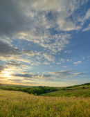 The landscape of the field with a spectacular sky — Stock Photo