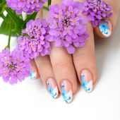Nail art and flower — Stock Photo