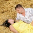 A couple in love at hay — Stock Photo