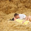 A couple in kissing at hay — Stock Photo #12024056