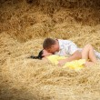 A couple in kissing at hay — Stock Photo