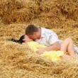 A couple in kissing at hay — Stock Photo #12024061