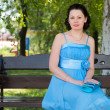 A beautiful woman in a blue dress — Stock Photo