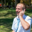 Young businessmof talks on phone in Park — Stock Photo #12024257