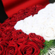Red and white roses in the church — Stock Photo