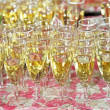 Full champagne flutes on a table — Stock Photo
