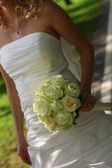 Bride holding her bouquet — Stock Photo