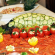 Decorative smoked salmon platter — Stock Photo #10820082