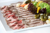 Tray of cold meats on a buffet table — Stock Photo