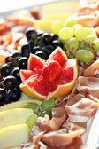 Decorative grapefruit garnish on a meat platter — Stock Photo