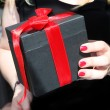 Female hand holding a gift — Stock Photo #10927391