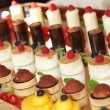 Rows of tasty looking desserts — Stok Fotoğraf #10927691