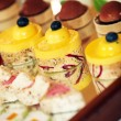 Стоковое фото: Rows of tasty looking desserts
