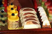 Dessert tray with decorative cakes — Stock Photo