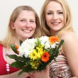 Happy women with a colourful bouquet — Stock Photo